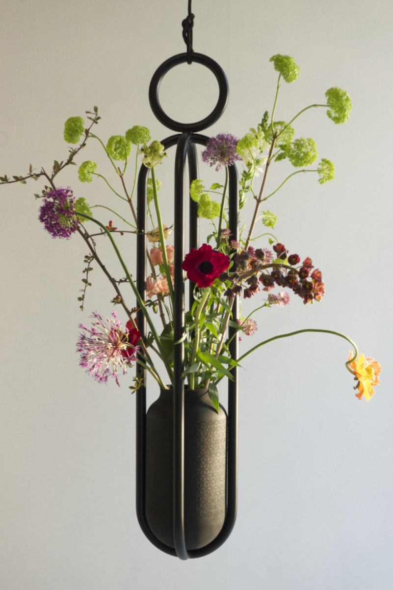 Another arrangement of cut flowers in the hard vase