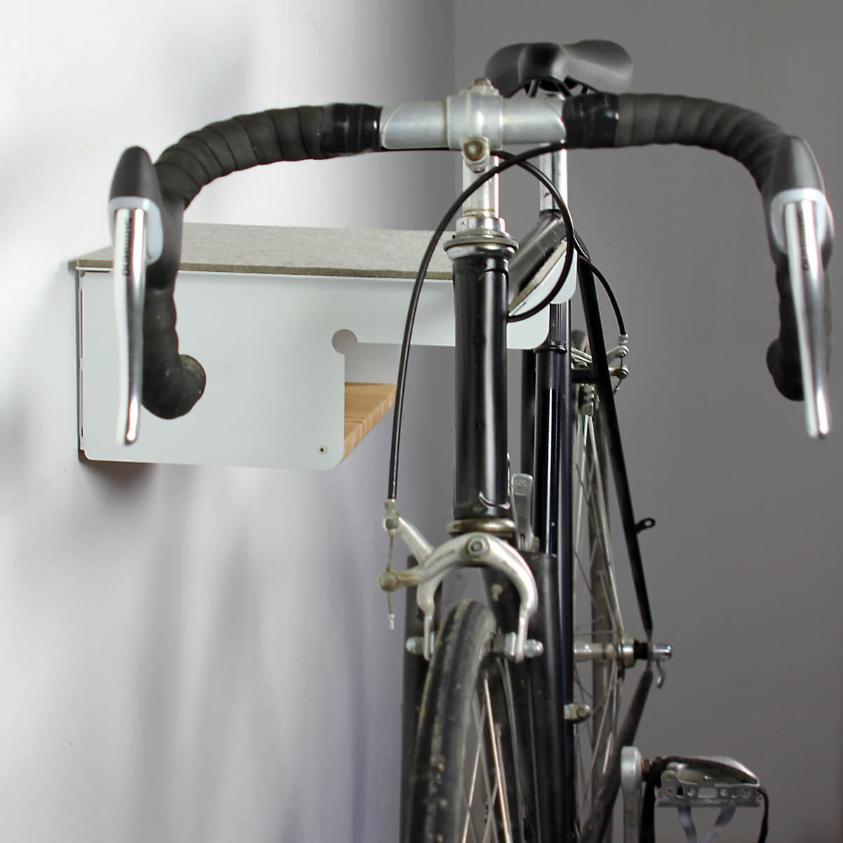 Wall holder for racing bicycles