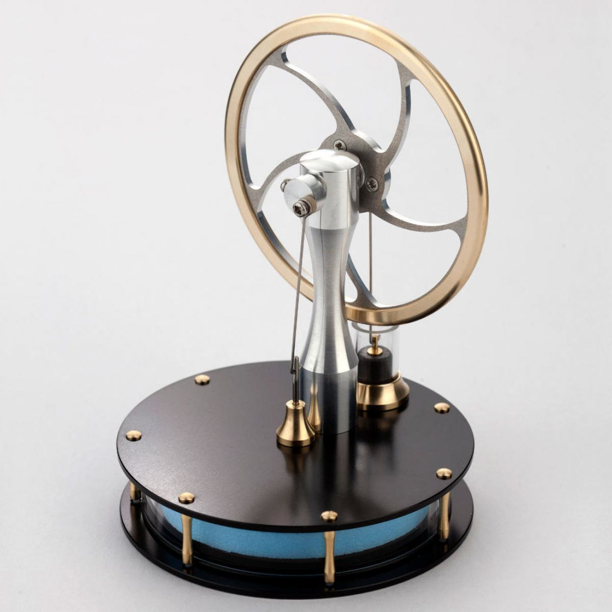 Stirling engine driven by hand warmth, sunlight, coffee etc
